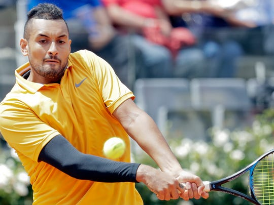 Nick Kyrgios was defaulted from the Italian Open after throwing a chair during his second-round match.