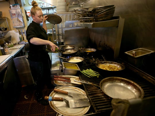 Agate Pass Cafe kitchen manager Julia Robinson adds