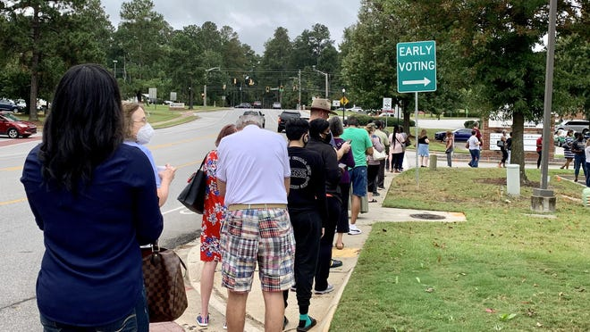 Over 50 people lined up and circle Building G3 in Evans to cast their vote during the first day of early voting Monday, Oct. 12.