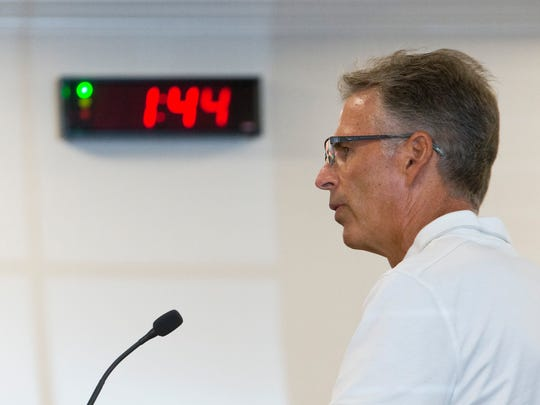 A timer counts down the allotted time to speak as Estero resident Doug Saxton informs the Village Council of an upcoming event him and his wife are planning to be held in the community during a Village of Estero Council meeting.