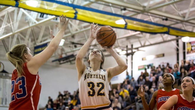 Port Huron Northern senior Bree Bauer takes a shot during a basketball game Wednesday, Jan, 4, 2017 at Port Huron Northern High School.