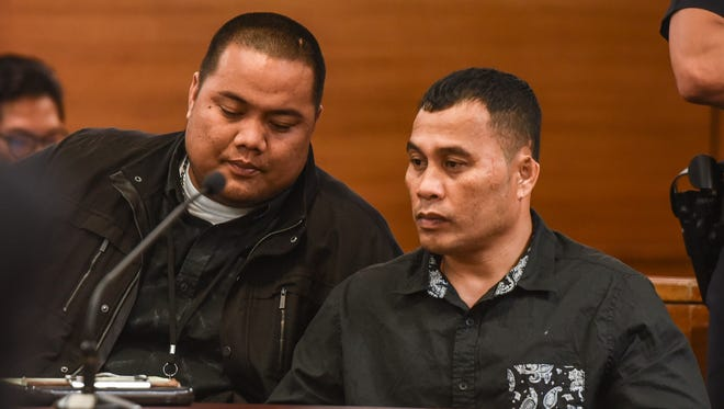 Defendant Mark Omwere, right, listens to Chuukese language translator Israel Yoshinobu as closing arguments are presented during Omwere's rape trial at the Superior Court of Guam in Hagåtña on April 3, 2017.