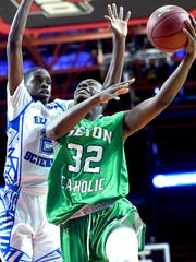 Seton Catholic's Marcus Dayes (32) goes up for a shot