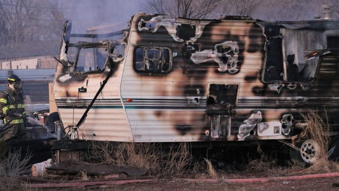 Fire officials continue their investigation of a camper and mobile home fire in the 1500 block of West Sixth Street Thursday in Tularosa.
