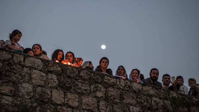 Yazidis gather at the shrine of Sheikh Adi ibn Musafir to celebrate their new year with the lighting of candles in Lalish, north of Mosul, Iraq, on April 19, 2016. Iraq has the biggest population of Yazidis worldwide with Lalish being their principal holy site.