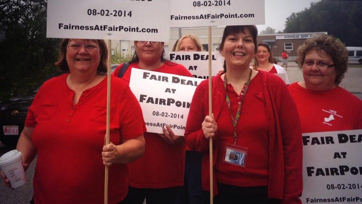 "Picketers were wearing red shirts and carrying signs that read ""Fair Deal at FairPoint."""