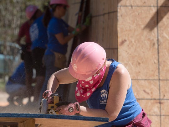 Gulf Power employee, Heather Madison, joins other volunteers working at the Habitat for Humanity Women's Build project in Milton Wednesday, Oct. 17, 2017.