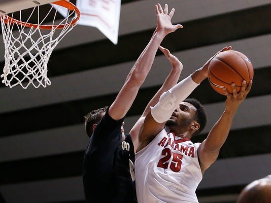 Alabama's Braxton Key (25) shoots the ball while guarded by Luke Kornet (3) during the second half  of an NCAA college basketball game in Tuscaloosa, Ala., Saturday, Jan. 7, 2017. (Erin Nelson/The Tuscaloosa News via AP)