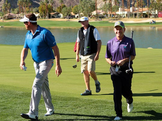 PGA Tour player Charlie Beljan (left) walks off the 18th green of the Palmer Private Course at PGA West with teammates in Eisenhower Bob Hope Legacy Pro-Am tournament on Wednesday, January 21, 2015 in La Quinta, Calif. Beljan towers at a height of 6 ft. 4 inches and is among the tallest golfers in the field for this week's Humana Challenge.