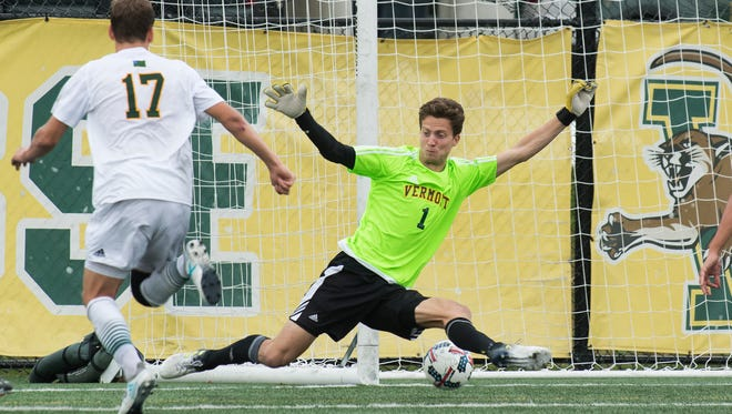 The ball gets past Vermont goalie Aron Runarsson (1) for an Albany goal during the men's soccer game between the Albany Great Danes and the Vermont Catamounts at Virtue Field on Saturday afternoon October 7, 2017 in Burlington.
