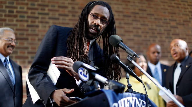 Attorney Michael Coard speaks during a news conference on Sept. 23 outside the U.S. Courthouse in Philadelphia. Coard is leading efforts by concerned alumni, staff and students from the historically black institution Cheyney University in southeastern Pennsylvania, to secure better state funding.
