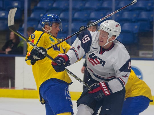 Action heats up Sunday between Sweden's Linus Hogberg (6) and USA White's Joey Anderson (19).