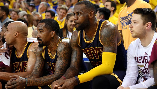 Cleveland Cavaliers forward LeBron James (23) and Cleveland Cavaliers guard J.R. Smith (5) sit on the bench near the end of a recent Finals game. James said the extra day between games gives the team some time to rest.