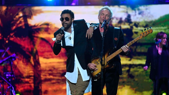 Shaggy (L) and Sting perform at The Queen's Birthday Party concert at the Royal Albert Hall in London on April 21, 2018 on the occassion of Britain's Queen Elizabeth II's 92nd birthday.