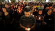 Hundreds of El Pasoans bow their heads in prayer during