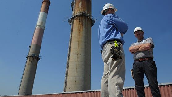 Tennessee Valley Authority's Thomas Cheney, left, and Larry Nathan stand on the roof of the electricity producer's Gallatin Fossil Plant.