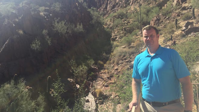 Ryan Wooddy of Paradise Valley stands in front of the ravine where he says many hikers often get off trail.