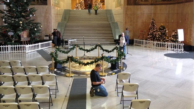 Silver Hare Productions sets up microphones in anticipation of the annual holiday celebrations in the Capitol rotunda on Friday, Nov. 28, 2014.