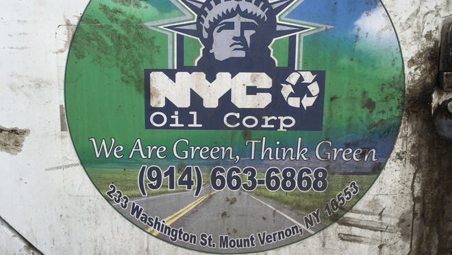 A close-up of a NYC Oil Corp. truck in the company's Mount Vernon parking lot on March 18, 2015. The company was fined $37,500 in November for contaminating the Hutchinson River with used cooking oil.