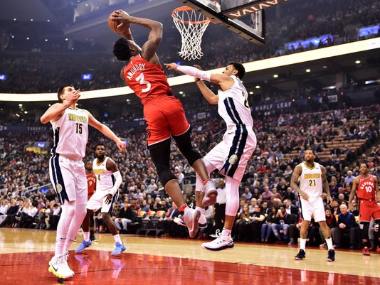 Toronto Raptors forward OG Anunoby (3) shoots over Denver Nuggets guard Jamal Murray (27) during first half NBA basketball action in Toronto on Tuesday, March 27, 2018. (Frank Gunn/The Canadian Press via AP)