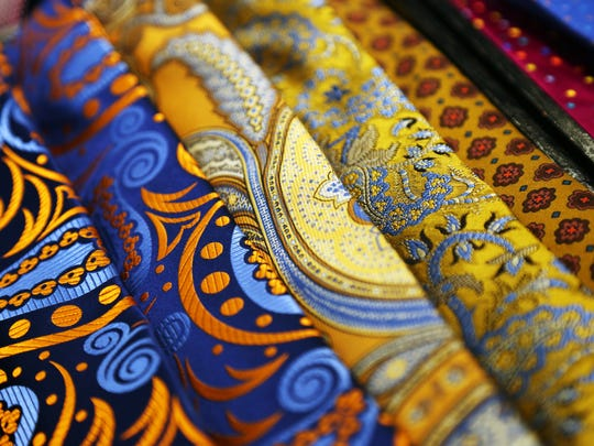 A colorful tie can give a dull suit a splash of color