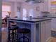 The renovated kitchen included quartz countertops.