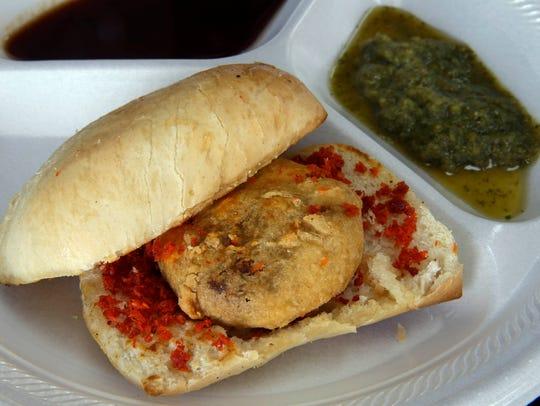 Vada pav, a spiced potato dumpling on a roll with chutney,