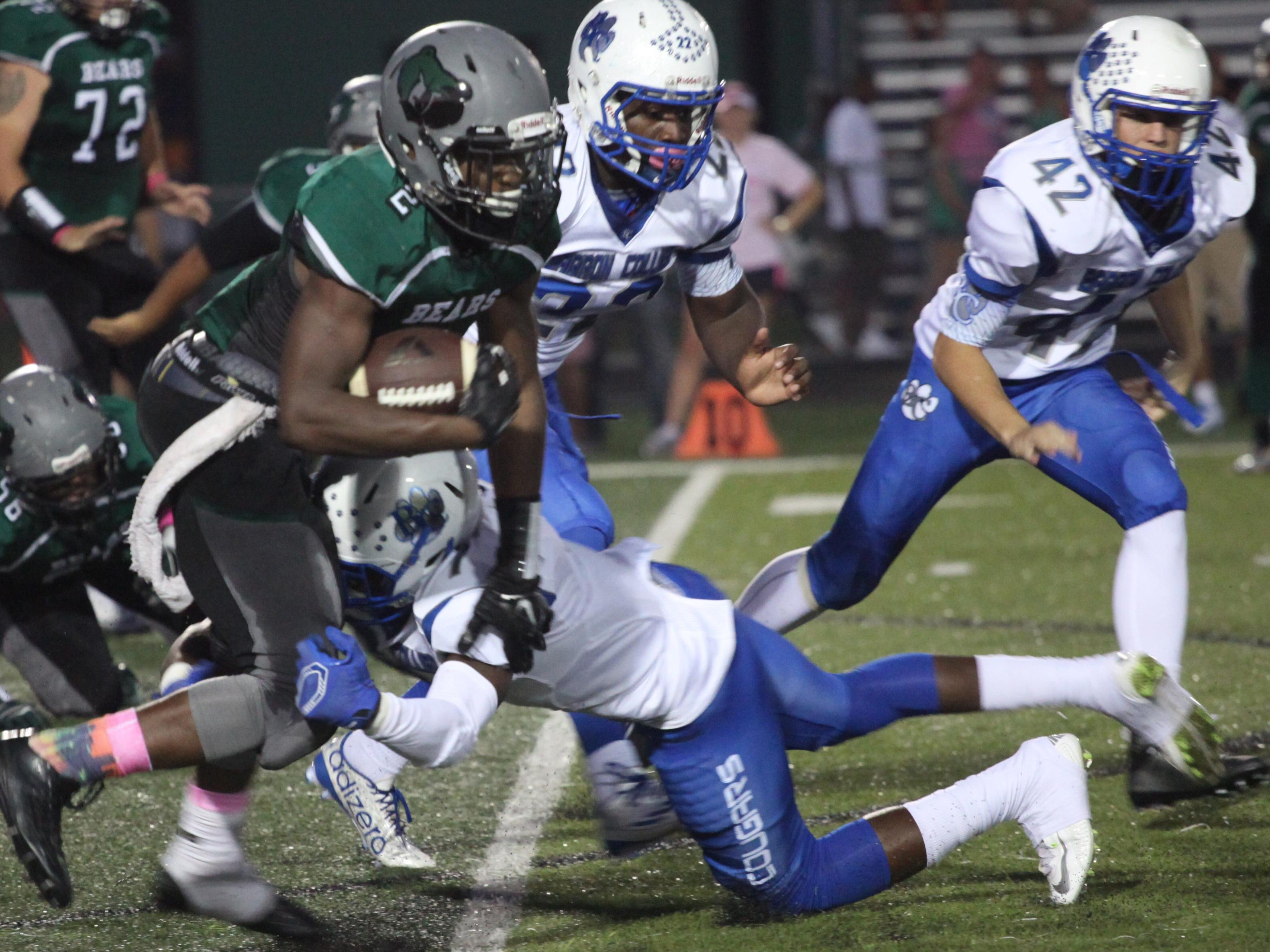 Palmetto Ridge's Jaheem Washington is tackled by Barron Collier's Jacine Olibrice during a game on Friday night.