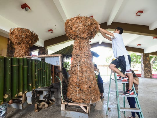 Mangilao Mayor's Office staff members and volunteers help construct the village's Liberation Day Parade float at the Mangilao Community Center on July 14, 2018.