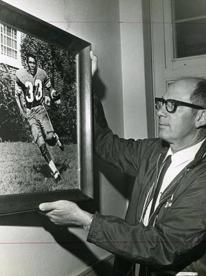 Savannah High School head football coach Arvel Homes examines an oil portrait of Larry Bartley, among the first African Americans to play varsity sports at the school. Bartley died Dec. 12, 1967 after a basketball game with Beach High School.  The brushed oil portrait was done by Bob Heriot and hung on April 3, 1968.