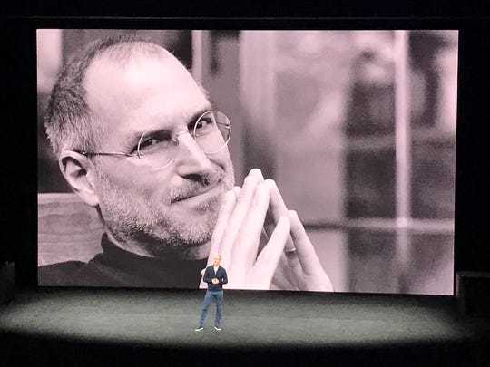 Tim Cook, Apple's current CEO, on stage reminiscing