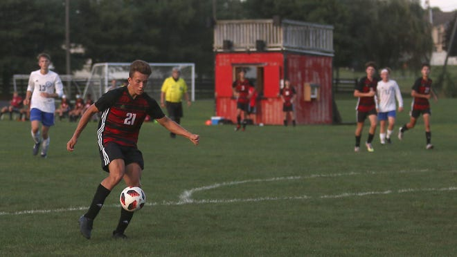New Philadelphia's Colin Roberts is ready to score a goal in the first half of the match with West Holmes Thursday evening at the Southside Community Park.
