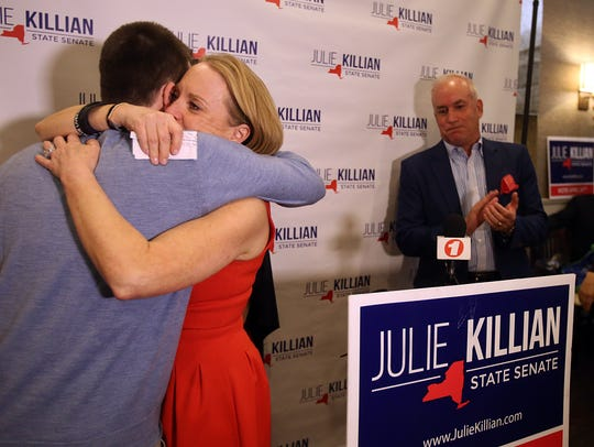 Republican Julie Killian hugs her son after losing