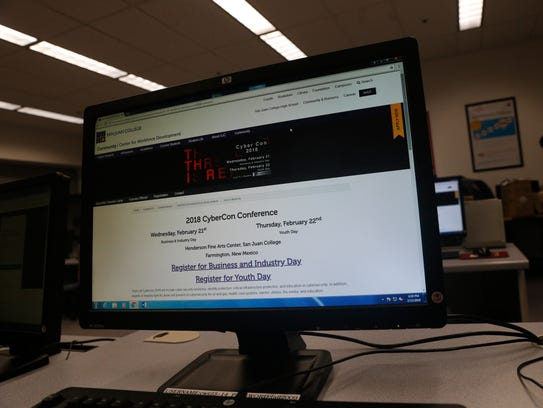 A computer screen at the San Juan College Quality Center for Business in Farmington shows information on the upcoming CyberCon 2018 event.
