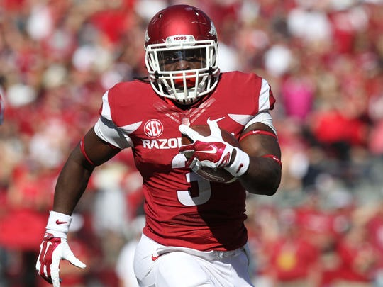 Running back Alex Collins impressed Arkansas teammates on Day 1 of preseason camp with his conditioning and lighter frame at 215 pounds.