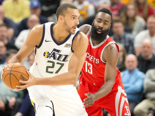 Houston Rockets guard James Harden (13) defends against Utah Jazz center Rudy Gobert (27) during the first half at Vivint Smart Home Arena.