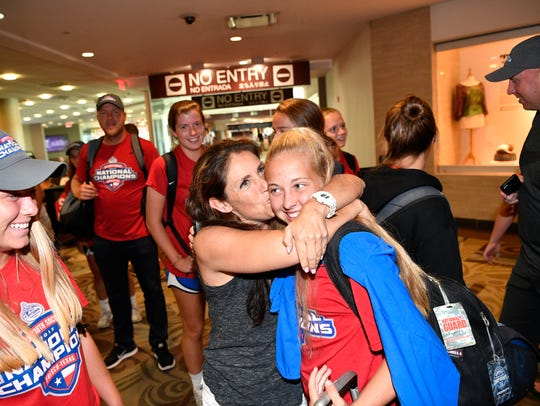 Coach Kyle Feldman hugs Lindsey Breskow as she arrive