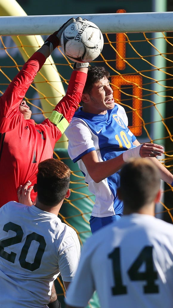 Yorktown goal keeper Maurico Arango makes a save in front of Mahopac's Augie Djerdjaj (10) during game against Mahopac at Yorktown High School Oct. 20, 2017.