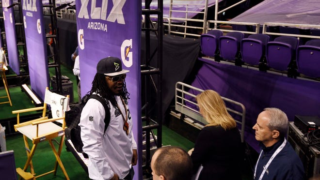Jan 27, 2015; Phoenix, AZ, USA; Seattle Seahawks running back Marshawn Lynch leaves his podium during media day for Super Bowl XLIX at US Airways Center. Mandatory Credit: Kyle Terada-USA TODAY Sports