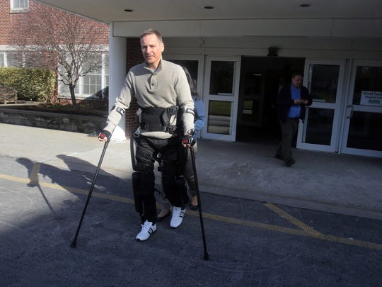 Rusty Chmelovsky, 39, a patient at Burke Rehabilitation Hospital in White Plains, walks with the ReWalk robotic exoskeleton device outside the hospital Dec. 20, 2017. Chmelovsky was left paralyzed from the waist down after a construction accident in 2008. The ReWalk device provides powered hip and knee motion to enable the him to stand upright, walk and turn.