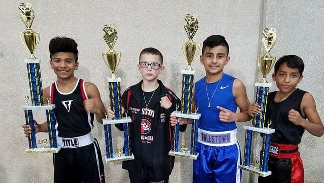Fallstown Boxing won four championships at the 2017 Golden Gloves event recently in Fort Worth. Left to right, Emanuel Moreno, junior open 11-12 years, 85 pounds; Ezekiel Mares, bamtam open, 10 years, 70 pounds; Emmanuel Carrillo, junior open, 11-12 years, 90 pounds;  and Juaquin Sanchez, bantam novice, 10 years, 65 pounds. The club sent 10 boxers to the event.