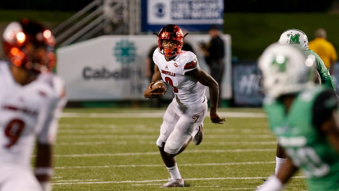 Louisville's Lamar Jackson had five passing touchdowns and two rushing touchdowns against Marshall. 
