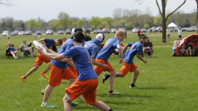 A St. Cloud Cathedral ultimate player winds up to throw the flying disc Sunday during the Granite City Classic.