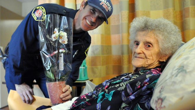 Wilma Hunsaker, 93, is pleased to have a visit on Mother's Day from firefighter Skylar Thornton as part of Alliance on Aging's I Remember Mama event at Windsor Skyline Care Center in Salinas.