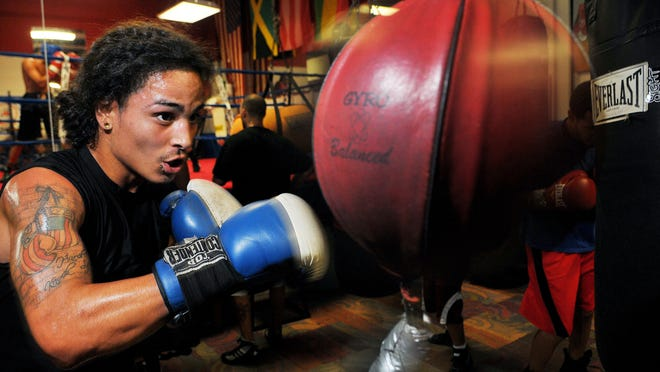 Joshua Pagan of Palm Bay works out at the Palm Bay Community Center boxing gym as he gets ready for a fight in Puerto Rico.