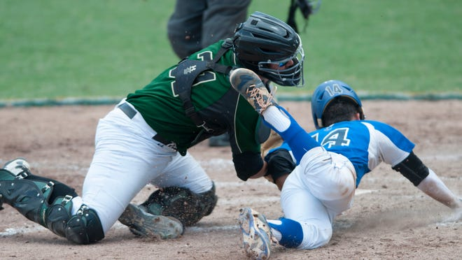 Canterbury's Jake Crandon is tagged out at home plate by Westminster's Jakob Zarrello during a semifinal game between the two teams. Westminster went on to win the game 4-2.
