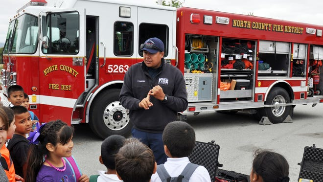 North County Firefighter Randy Sanchez explains some of the functions of his urban search-and-rescue vehicle at Wednesday's annual Emergency Medical Services Week event in Salinas.