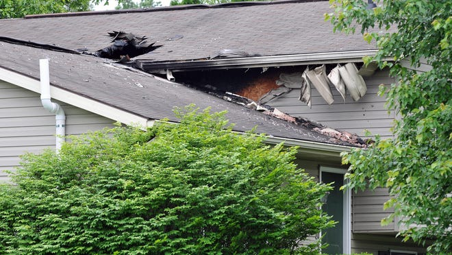 Fire damage is visible at a house for sale at 7500 Ohio 42 in Johnsville.