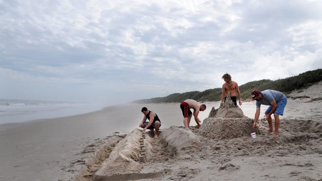 Craig Bailey/FLORIDA TODAYJosh Hoobler, Micah Dority, Nathan Dority and Don Dority build a sand castle at Playalinda Beach, part of the Canaveral National Seashore. A recent USA Today online reader survey ranked Playalinda, east of Titusville, fourth-best seashore in Florida and best of the Atlantic beaches. Josh Hoobler, Micah Dority, Nathan Dority and Don Dority build a sand castle at Playalinda Beach, part of the Canaveral National Seashore.