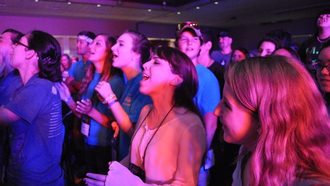 Thousands of youth sing together Saturday afternoon during Steubenville South at the Alexandria Riverfront Center.